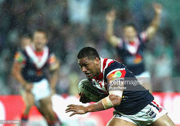Frank Paul Nuuausala of the Roosters crosses to score the winning try during the round 24 NRL match between the Sydney Roosters and the Cronulla...