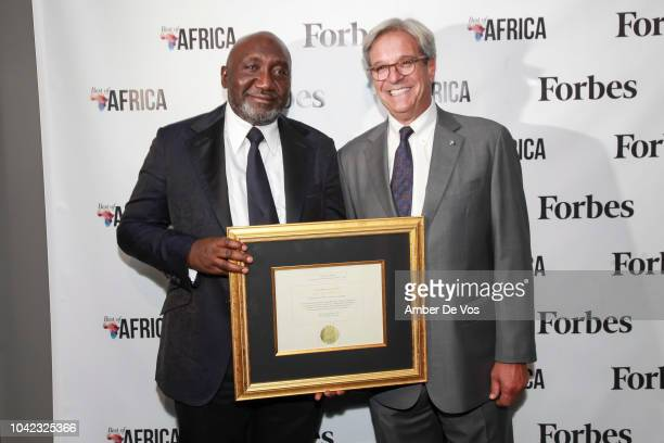 Frank Peters and Mike Perlis pose with award at Benedict Peters Receives Forbes Best Oil and Gas Leader of the Year Award Africa at Forbes...
