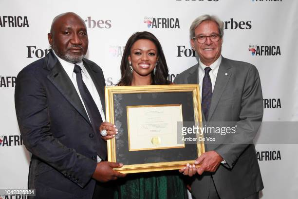 Frank Peters Ella Peters and Mike Perlis pose with award at attend Benedict Peters Receives Forbes Best Oil and Gas Leader of the Year Award Africa...