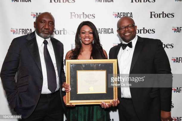 Frank Peters Ella Peters and Oliver Okafor pose with award at Benedict Peters Receives Forbes Best Oil and Gas Leader of the Year Award Africa at...