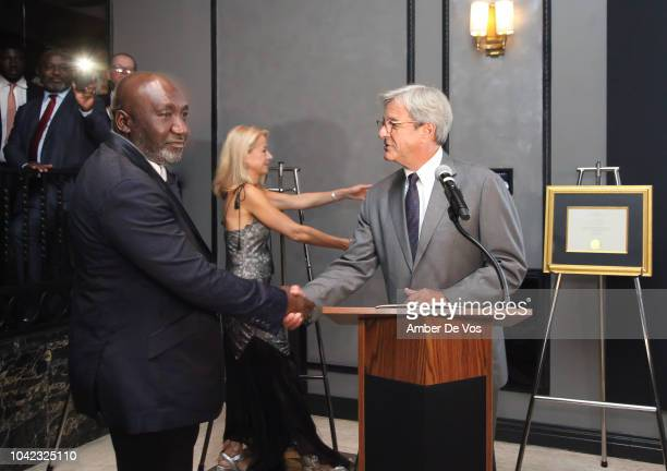 Frank Peters receives an award from Mike Perlis at Benedict Peters Receives Forbes Best Oil and Gas Leader of the Year Award Africa at Forbes...
