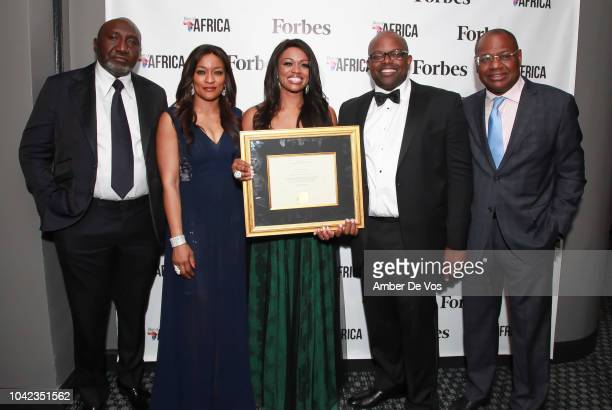 Frank Peters Uju Obuekwe Ella Peters Oliver Okafor and Paul Trustful pose with award at Benedict Peters Receives Forbes Best Oil and Gas Leader of...