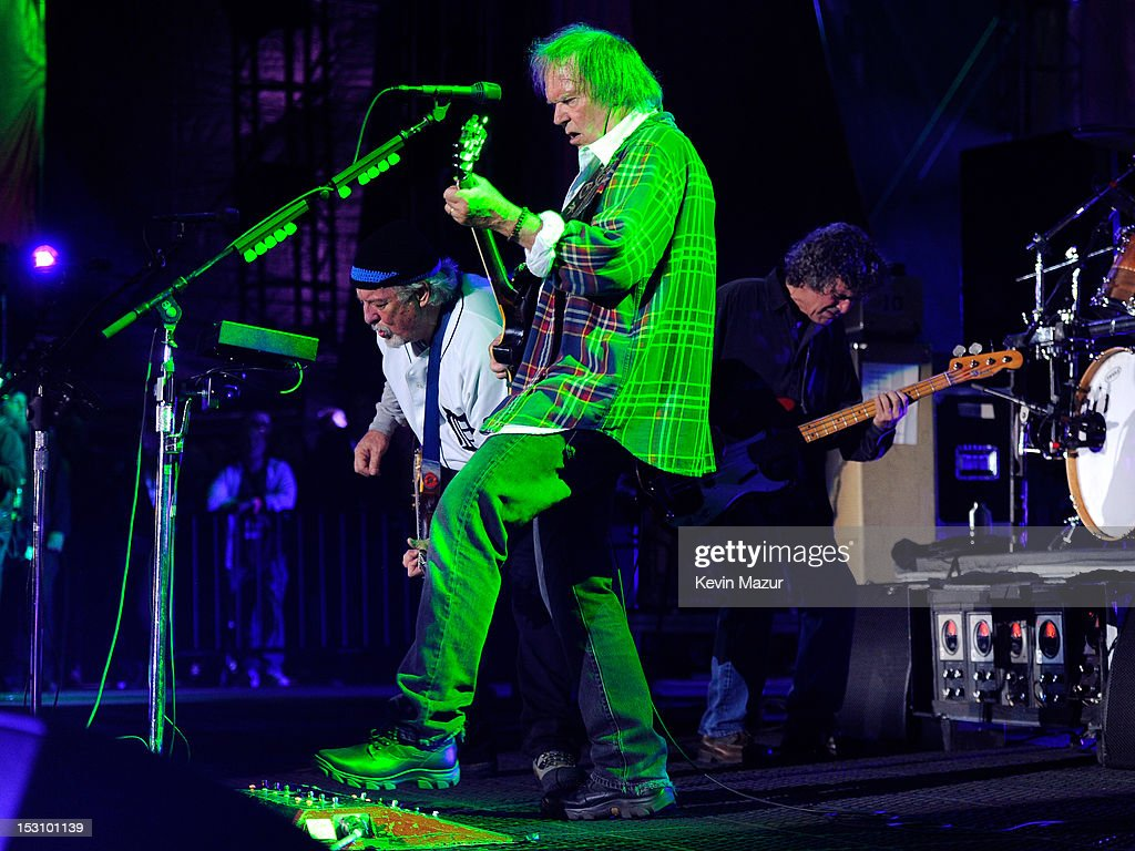 Frank 'Poncho' Sampedro, Billy Talbot and Neil Young of Neil Young and Crazy Hourse perform onstage at the The Global Citizen Festival in Central Park to end extreme poverty - Show at Central Park on September 29, 2012 in New York City.