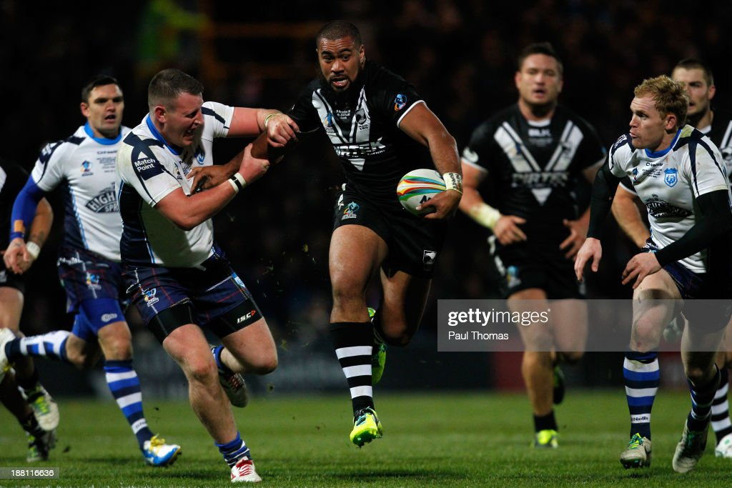 Frank Pritchard of New Zealand (C) in action with Sam Barlow of Scotland during the Rugby League World Cup Quarter Final match between New Zealand and Scotland at Headingley Stadium on November 15, 2013 in Leeds, England.