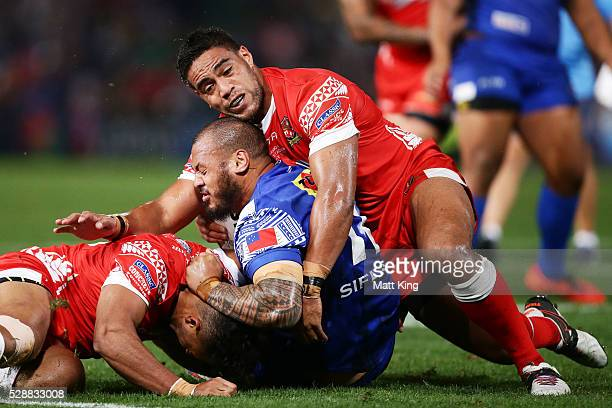 Frank Pritchard of Samoa is tackled during the International Rugby League Test match between Tonga and Samoa at Pirtek Stadium on May 7 2016 in...