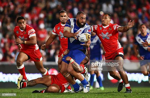 Frank Pritchard of Samoa offloads the ball in a tackle during the International Rugby League Test match between Tonga and Samoa at Pirtek Stadium on...