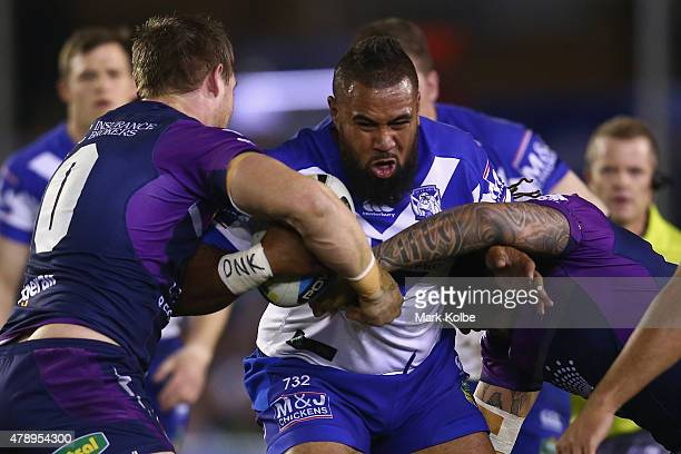 Frank Pritchard of the Bulldogs is tackled during the round 16 NRL match between the Canterbury Bulldogs and the Melbourne Storm at Belmore Sports...