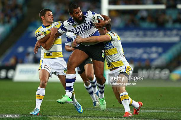 Frank Pritchard of the Bulldogs is tackled during the round 20 NRL match between the Canterbury Bulldogs and the Parramatta Eels at ANZ Stadium on...