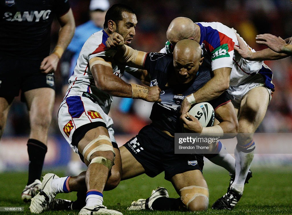 Frank Puletua of the Panthers is tackled by the Knights defence during the round 13 NRL match between the Penrith Panthers and the Newcastle Knights at CUA Stadium on June 5, 2010 in Sydney, Australia.