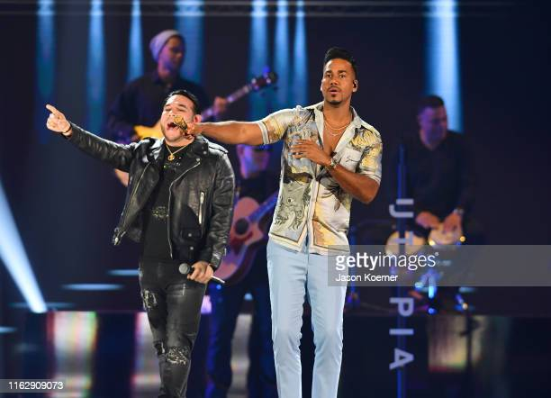 Frank Reyes and Romeo Santos perform on stage during Premios Juventud 2019 at Watsco Center on July 18 2019 in Coral Gables Florida