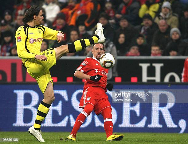 Frank Ribery of Bayern and Neven Subotic of Dortmund compete for the ball during the Bundesliga match between FC Bayern Muenchen and Borussia...