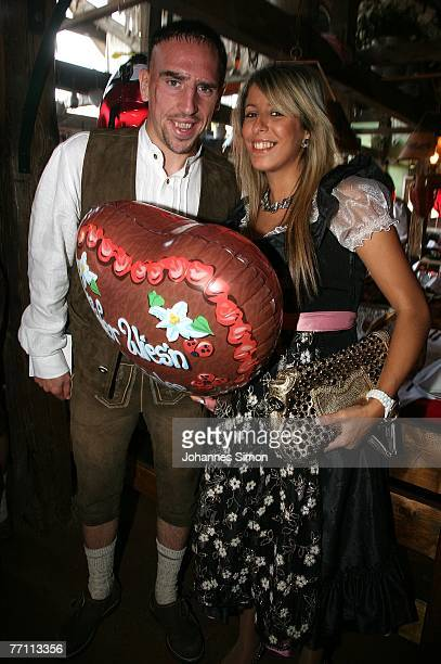 Frank Ribery of Bayern Munich and his wife Wahiba arrive at the Kaefers party tent for a day at the Oktoberfest on September 30 2007 in Munich Germany