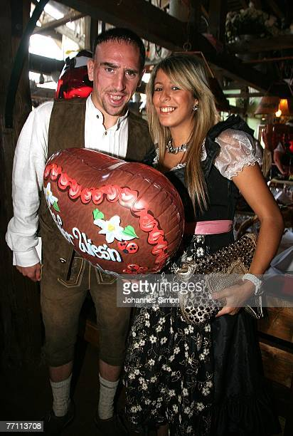 MUNICH GERMANY SEPTEMBER 30 Frank Ribery of Bayern Munich and his wife Wahiba arrive at the Kaefers party tent for a day at the Oktoberfest on...