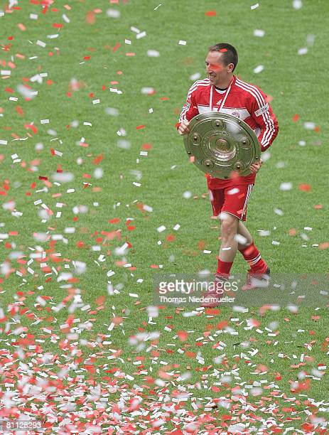 Frank Ribery of Bayern Munich celebrates with the trophy winning the German championships after the Bundesliga match against Hertha BSC Berlin at the...