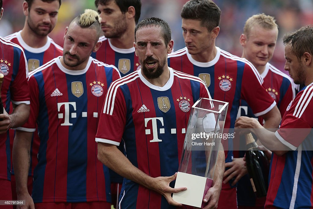 Frank Ribery of Munich with the trophy after the Telekom Cup 2014 Finale match between FC Bayern Muenchen and Borussia Moenchengladbach at Imtech Arena on July 27, 2014 in Hamburg, Germany.