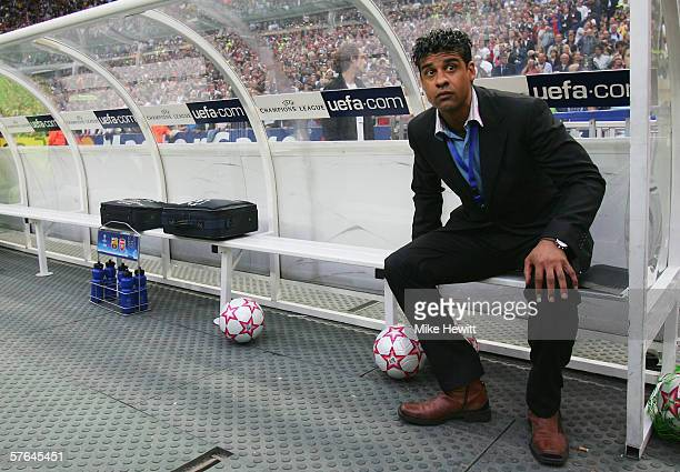 Frank Rijkaard manager of Barcelona takes his seat on the bench prior to the UEFA Champions League Final between Arsenal and Barcelona at the Stade...