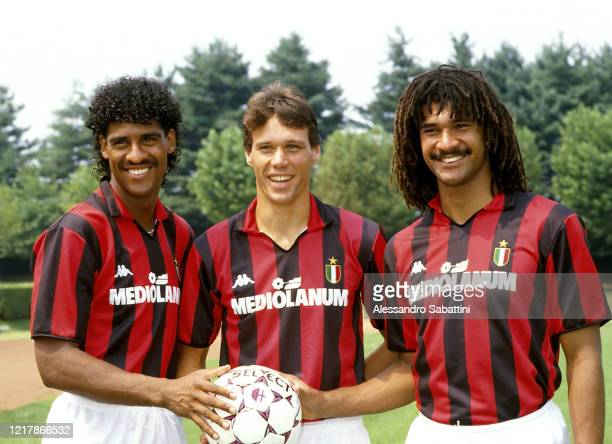 Frank Rijkaard, Marco Van Basten and Ruud Gullit of AC Milan pose for photo after training session, Italy.