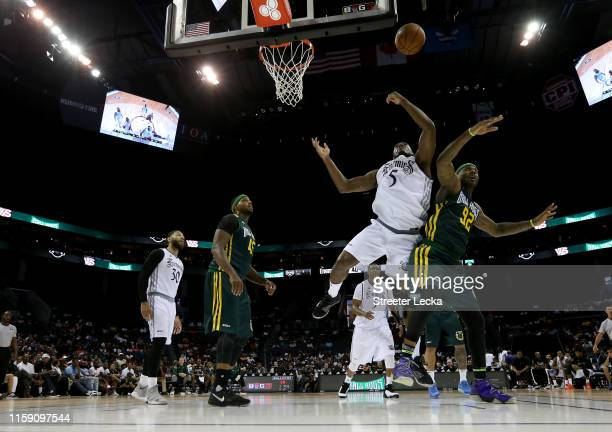 Frank Robinson of Enemies and DeShawn Stevenson of Ball Hogs compete for possession during week two of the BIG3 three on three basketball league at...