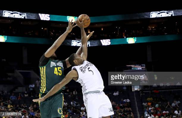 Frank Robinson of Enemies defends Will McDonald of Ball Hogs during week two of the BIG3 three on three basketball league at Spectrum Center on June...