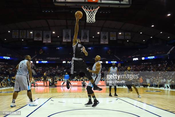 Frank Robinson of the Enemies attempts a shot while being guarded by Corey Maggette of the Power in the second half during week seven of the BIG3...