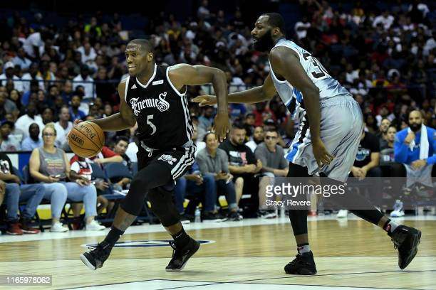 Frank Robinson of the Enemies dribbles the ball while being guarded by Julian Wright of the Power during week seven of the BIG3 three on three...