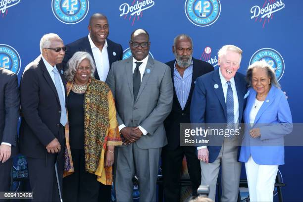 Frank RobinsonSharon RobinsonMagic Johnson Branly Cadet David Robinson Vin Scully and Rachel Robinson pose for a picture at the unveiling of the...