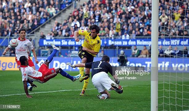 Frank Rost and Ze Roberto of Hamburg save a shot by Mats Hummels of Dortmund during the Bundesliga match between Hamburger SV vandBorussia Dortmund...