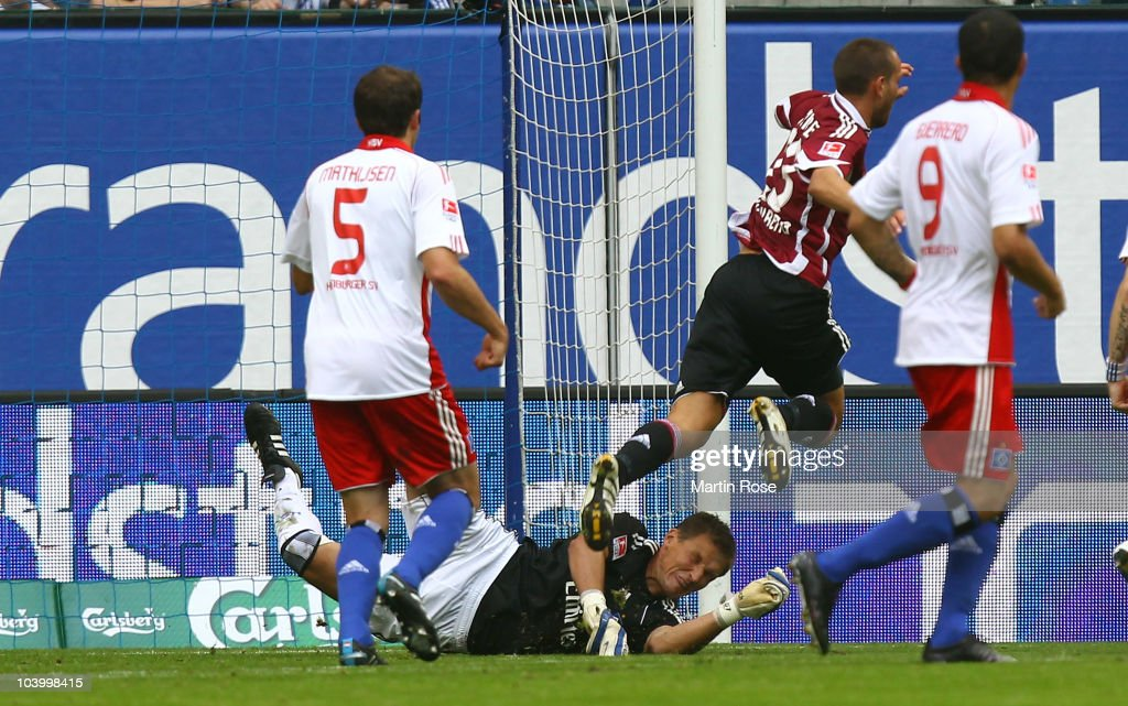 Frank Rost, goalkeeper of Hamburg fouls Julian Schieber (R) of Nuernberg during the Bundesliga match between Hamburger SV and 1. FC Nuernberg at Imtech Arena on September 11, 2010 in Hamburg, Germany.
