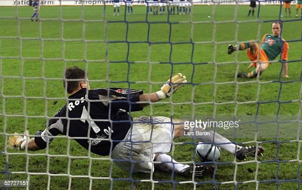 Frank Rost, goalkeeper of Schalke, saves a penalty against Fabian Ernst of Bremen during the DFB Pokal Semi Final Match between FC Schalke 04 and...
