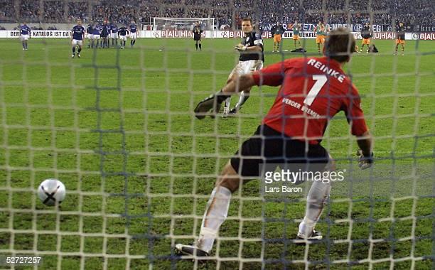 Frank Rost, goalkeeper of Schalke, scores the winning penalty during the DFB Pokal Semi Final Match between FC Schalke 04 and Werder Bremen, at the...