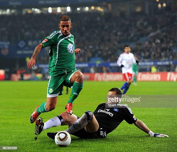 Frank Rost of Hamburg challenges Ashkan Dejagah of Wolfsburg during the Bundesliga match between Hamburger SV VfL Wolfsburg at HSH Nordbank Arena on...