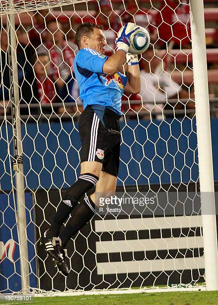 Frank Rost of the New York Red Bulls blocks a goal attempt by FC Dallas during the wild card match at Pizza Hut Park on October 26 2011 in Frisco...