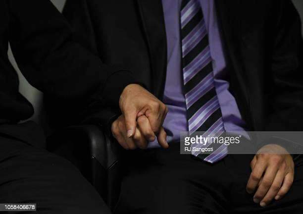 Frank Rzucek father of Shanann Watts left holds his son Frankie Rzucek's hand as they listen to the Weld County District Attorney Michael J Rourke...