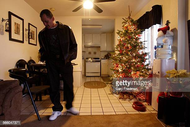 Frank Santiago is photographed in his Lakewood home on December 15 2010 A plumber by trade he had his company van ticketed and impounded when he was...