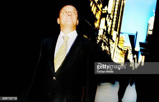 Frank Sartor MP responsible for new pavings and widening of pathways in Sydney's CBD Photo on location at cnr of Pitt St and Martin Place 23 June...