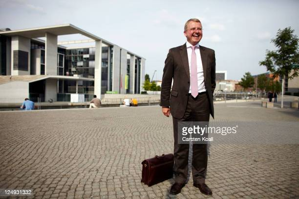 Frank Schaeffler member of the parliament of the German Free Democrats political party at the German Parliament poses laughing during a portrait...