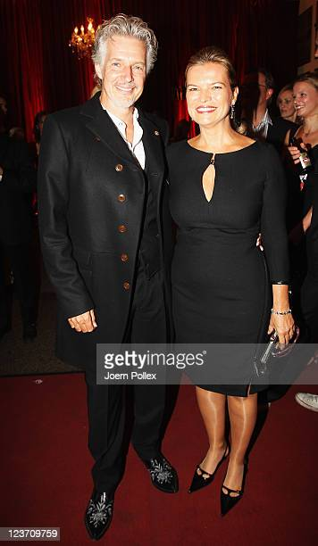 Frank Schaetzing and Sabina Valkieser attend the Day of Legends gala Night of Legends at the Schmitz Tivoli theatre on September 4, 2011 in Hamburg,...