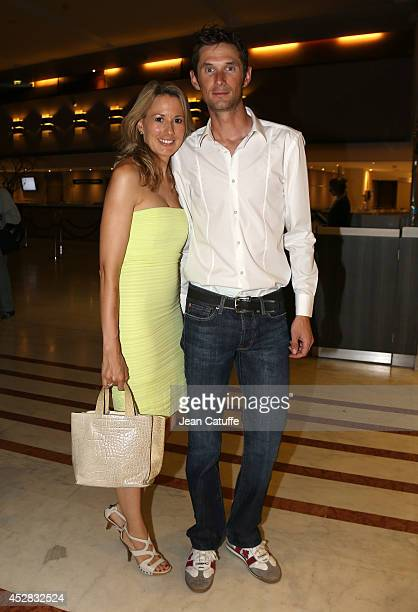 Frank Schleck and his wife Martine Schleck leave their hotel on their way to the riders' party after the twenty one and last stage of the 2014 Tour...