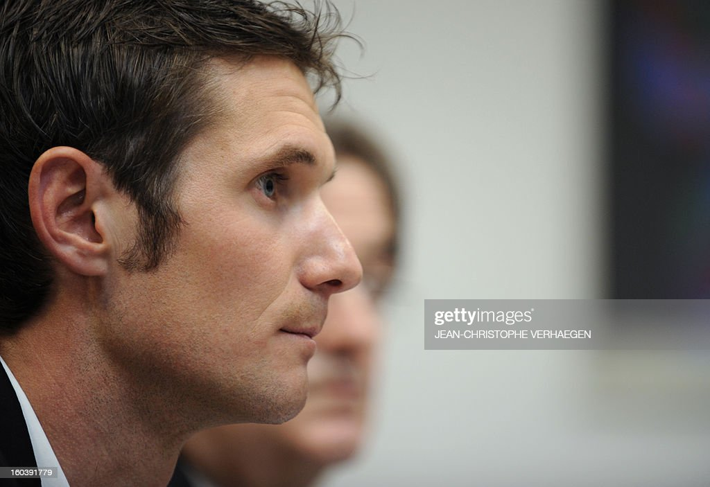 Frank Schleck, tested positive for a diuretic (Xipamide) on the Tour de France 2012, arrives at a press conference after the decision of the Luxembourg Anti-Doping Agency (Agence Luxembourgeoise Antidopage - ALAD), on January 30, 2013 in Luxembourg. Schleck was banned for one year by Luxembourg's anti-doping body on Wednesday for failing a drugs test on last year's Tour de France, the body's president Robert Schuller announced. CHRISTOPHE VERHAEGEN