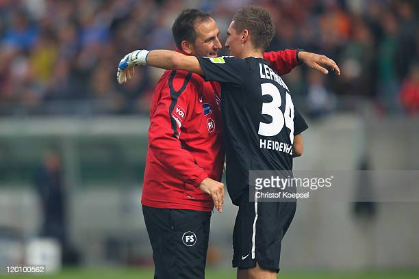 Frank Schmidt and Frank Lehmann of Heidenheim celebrate the 2-1 victory after the first round DFB Cup match between 1. FC Heidenheim and Werder...