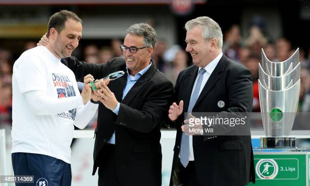 Frank Schmidt , head coach of Heidenheim is honored as coach of the season 2013/2014 by Peter Frymuth and Helmut Sandrock of the DFB after the Third...