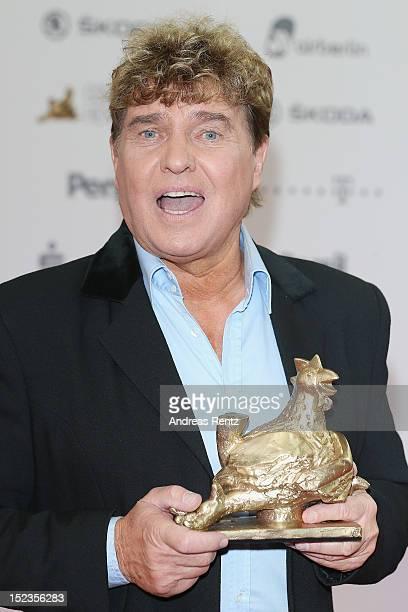 Frank Schoebel holds up his award at 'Goldene Henne' 2012 award on September 19 2012 in Berlin Germany