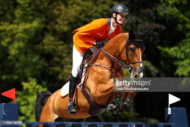 Frank Schuttert of Netherlands riding Lyonel D competes during Day 3 of the Longines FEI Jumping European Championship speed competition against the...