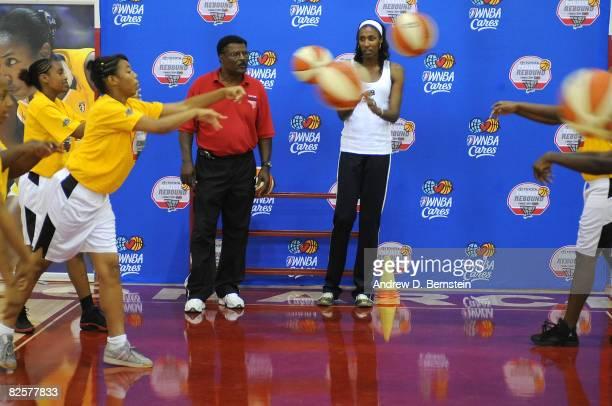 Frank Scott Athletic Director of Morningside High School and Lisa Leslie of the Los Angeles Sparks gives basketball handling instruction to...