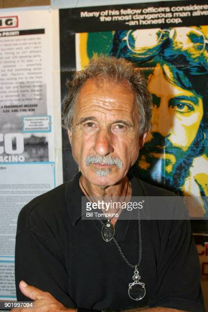 Frank Serpico former New York City Police Officer poses in front of the movie poster SERPICO starring Al Pacino at the Quad Cinema movie theatre on...