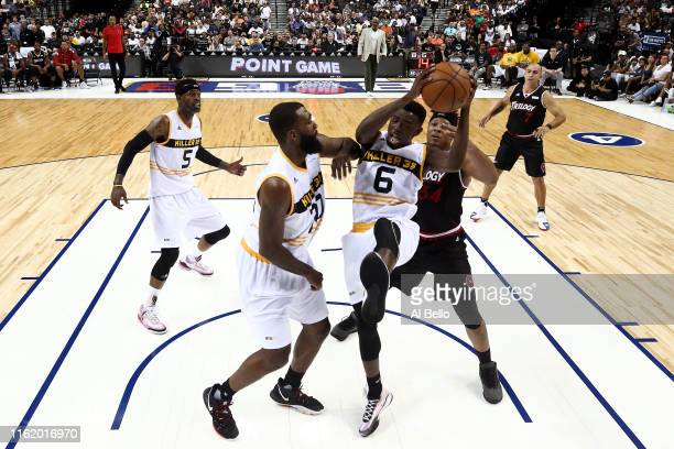 Frank Session of Killer 3s grabs a rebound against David Hawkins of Trilogy during week four of the BIG3 three-on-three basketball league at Barclays...