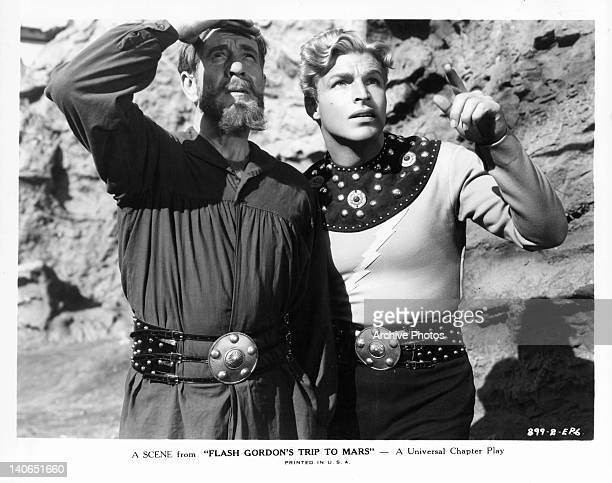 Frank Shannon and Buster Crabbe looking up in a scene from the film 'Flash Gordon's Trip To Mars' 1938