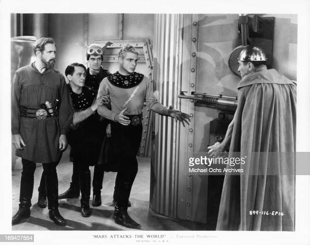 Frank Shannon Donald Kerr Kane Richmond and Buster Crabbe face off against a man in a scene from the film 'Mars Attacks The World' 1938