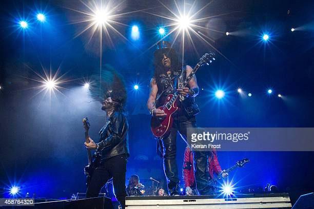 Frank Sidoris and Slash performs on stage at 3Arena on November 10, 2014 in Dublin, Ireland.