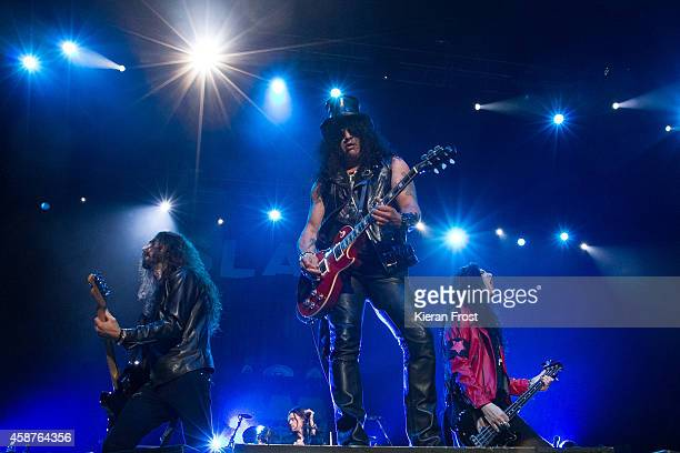 Frank Sidoris, Slash and Todd Kerns performs on stage at 3Arena on November 10, 2014 in Dublin, Ireland.